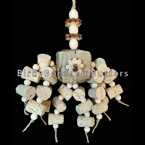 New design! Two dozen corks with lots of little wood beads hanging from a palm cube with pine daisies and wood beehive beads. Designed for intermediate sized birds.  Hangs approx 6