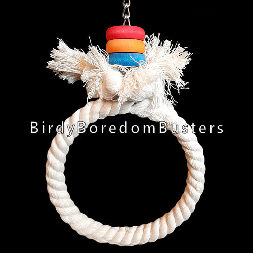 100% cotton rope twisted around a steel ring with brightly colored wood rings on nickel plated chain. Recommended for cockatiels and quaker parakeets up to senegals, sun conures and caiques.   Measures approx 5-1/2