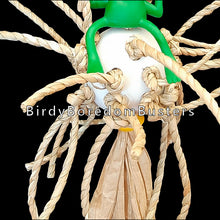 "Load image into Gallery viewer, Twisted seagrass cord knotted on a perforated golf ball with a rubber frog and small wood beads. Toy hangs on paper twist rope. Birds love chewing on the crunchy seagrass and paper rope!  Measures approx 5"" by 9"" including link."