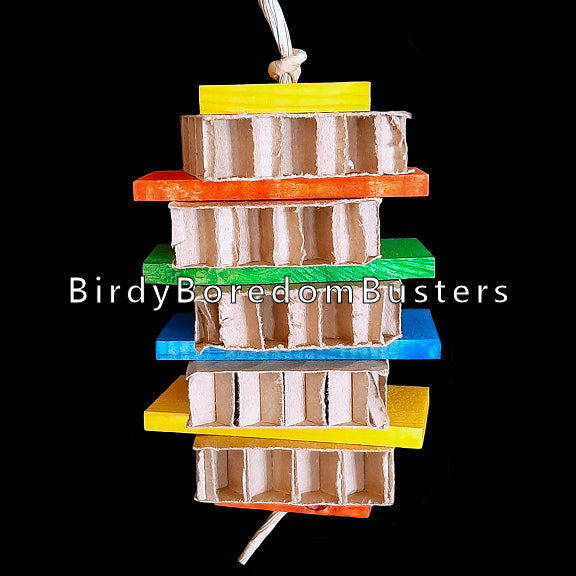 Brightly colored pine wood slats and cardboard honeycomb blocks threaded on paper twist rope. A perfect toy for birds who are light chewers and prefer softer textures.  Hangs approx 12