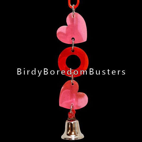 Extra thick crystal colored acrylic shapes in pink and red with a nickel plated bell to ring at the bottom.  Hangs approx 8