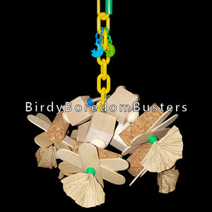 "A combination of balsa blocks, cork stoppers, thin wood paddles and paper bows on a length of plastic chain. A shredders dream come true!  Designed for small to intermediate sized birds. Measures approx 7"" by 8"" including link."