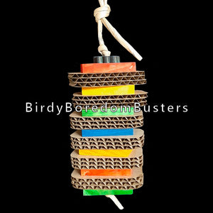 "2"" by 3"" cardboard slices with brightly colored softwood slats stacked on paper twist rope. A perfect combination of paper shredding & wood chipping fun! Contains no metal parts.  Hangs approx 12"" including link."