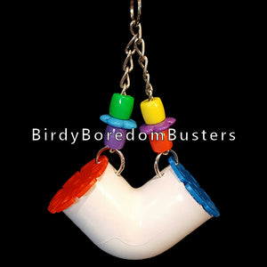 "A PVC tube on nickel plated chain with assorted beads & rings. The lids flip up to encourage foraging activity. Fill with your bird's favorite food, treats or small toys. Designed for cockatiels, lovebirds, parrotlets, budgies, small conures, etc. Hangs approx 3"" by 6-1/2"" including link."