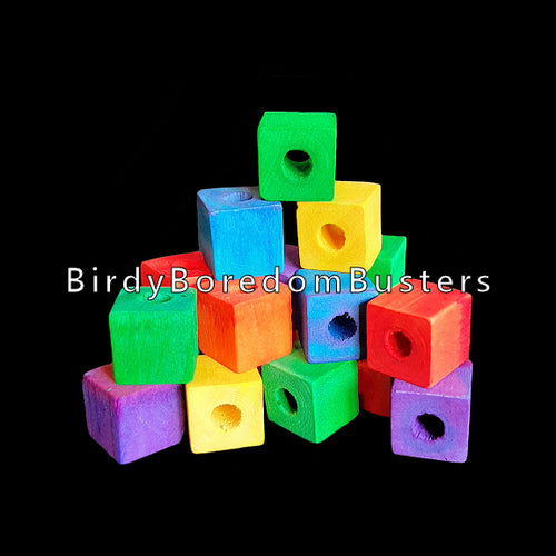 Small, brightly colored soft wood cubes measuring approx 5/8