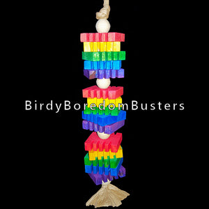 "Brightly colored 3/8"" thick notched pine slices and wood beads strung on a double strand of paper twist rope. This toy contains no metal parts.  Measures approx 1-1/2"" by 12"" including link."