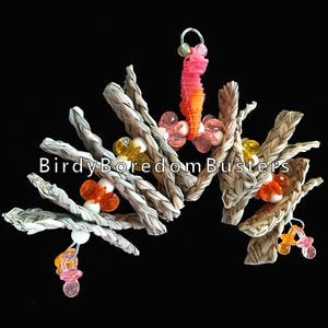 Lots of crunchy braided seagrass strips with small wood beads and starburst beads strung on stainless steel wire under a little seahorse. Designed for small birds who like to shred.