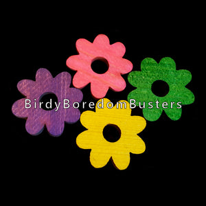 "Brightly colored soft wood pine flowers measuring 1"" by 1/4"" thick with a 1/4"" center hole.   Package contains 10 pieces."