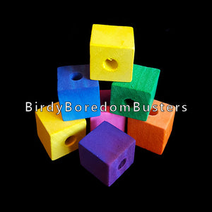 "Bulk brightly colored soft wood cubes measuring approx 3/4"" with a 1/4"" hole to make your own bird toys. Package contains 50 pieces."