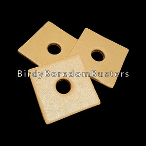 "Bird-safe vegetable tanned leather squares measuring 1-1/2"" by 1-1/2"" with a 3/8"" center hole."