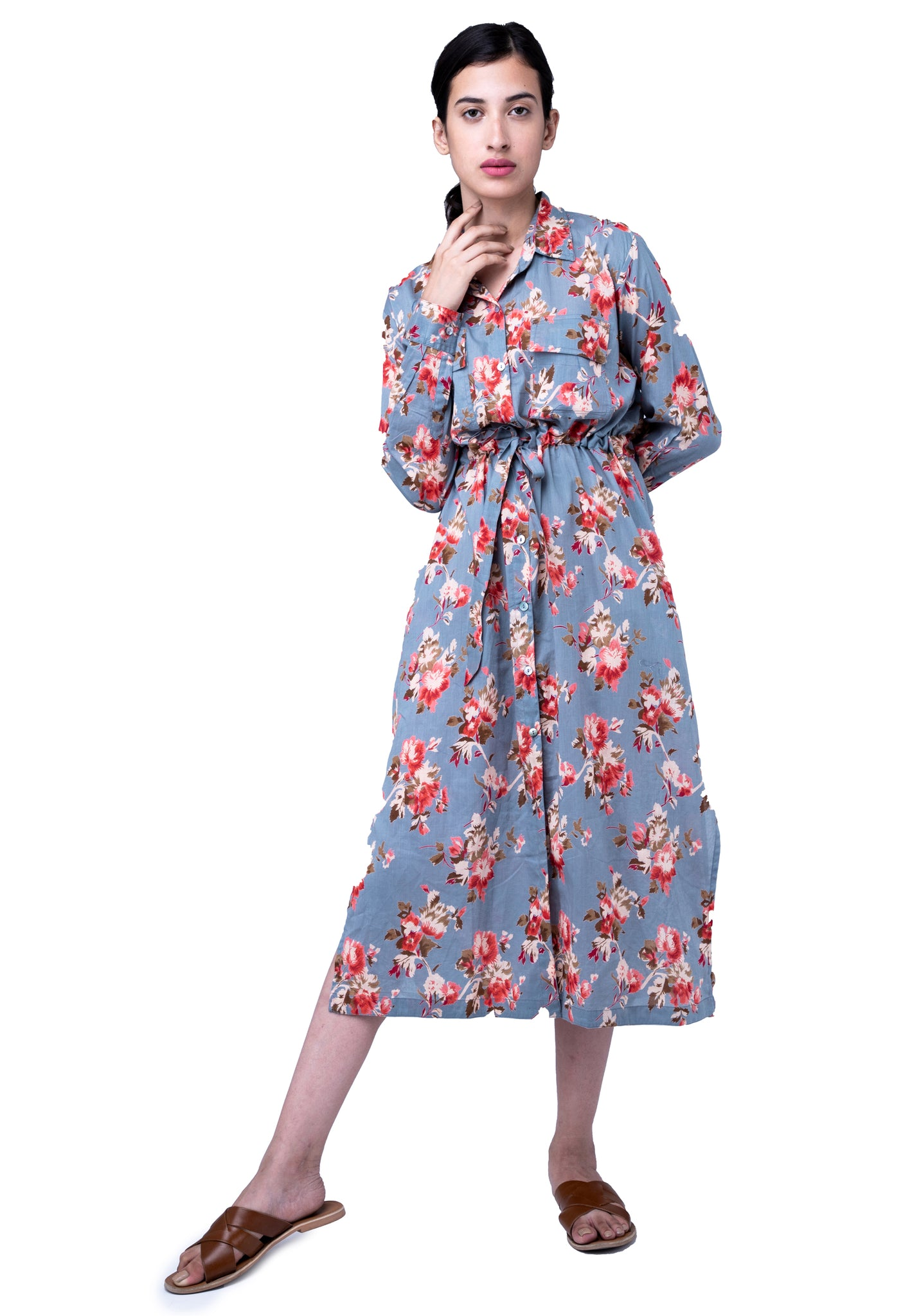 A long shirt dress with patch pockets and tie belt
