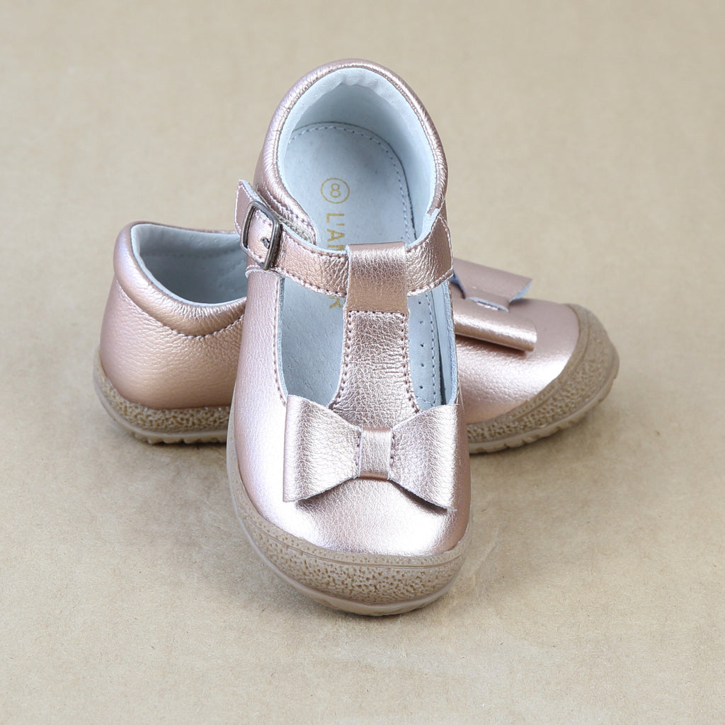 L'Amour Girls Rosegold Metallic Pebbled Leather Stitched Bow T-Strap Mary Jane - Petitfoot.com