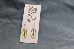 Tiny fern gold oval dangle earrings