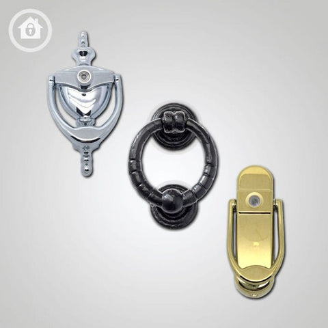 black cat banging door knocker