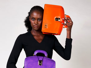Luxury fashion British brand DIDI Creations handmade leather briefcase bag orange briefcase purple briefcase orange bag orangeleatherbag bosslady executive luxury bag madeinitaly with ethically sourced genuine leather by didicreations women fashion.
