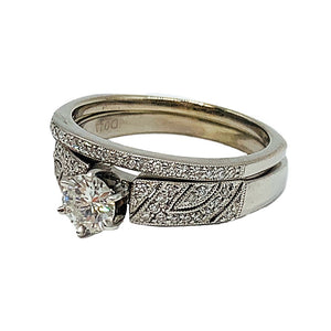 0.89 ctw 14k white gold bridal set w/ a 0.58CT round center diamond and matching band