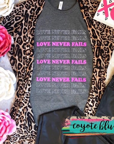 """LOVE NEVER FAILS"" TEE - Coyote Blu"