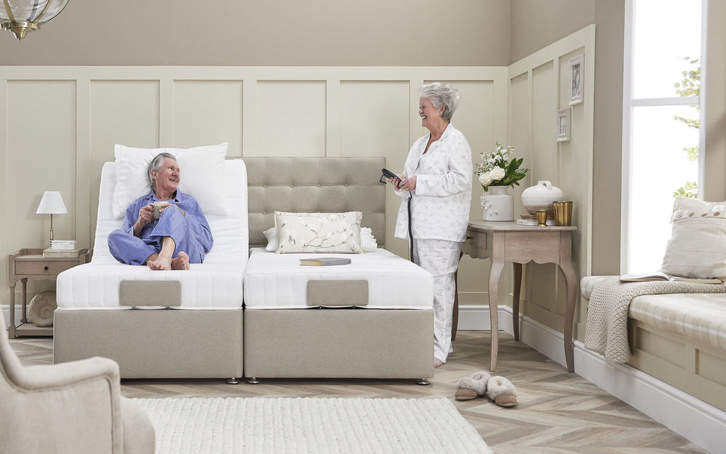 Couple using their double adjustable bed