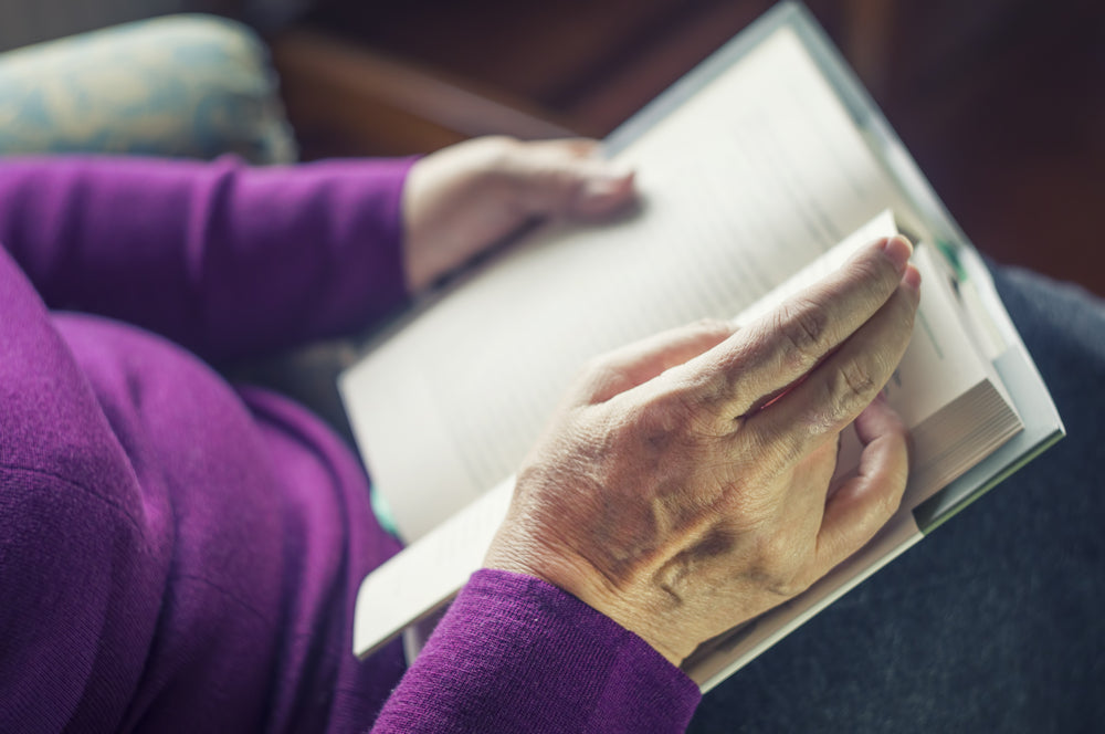 well-rested older woman reading a book