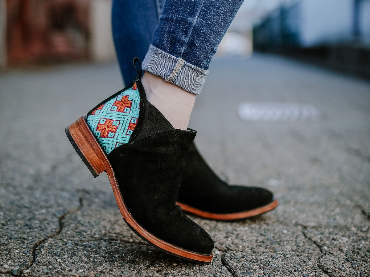 women's handcrafted small batch leather boots, women's fashion and lifestyle model with jeans