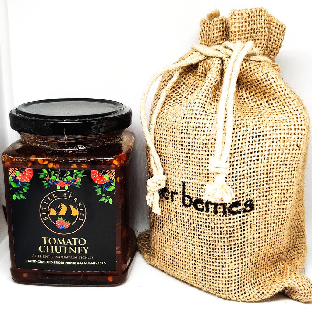 Tomato Chutney with dry fruits in a Glass jar comes with Jute bag outer packing