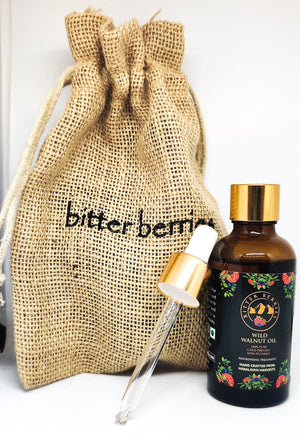 Natural Wild Walnut Oil in a smaller bottle with a dropper for easy application