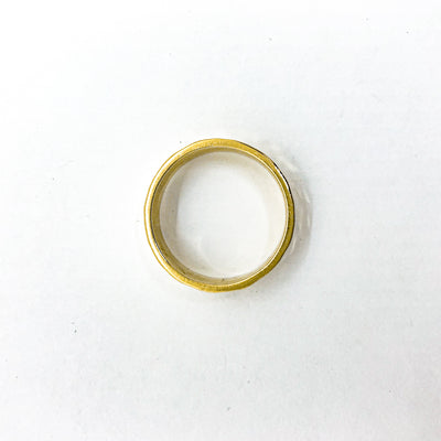over top view of 8mm 14k Gold Hammered Band in size 8 by Judie Raiford