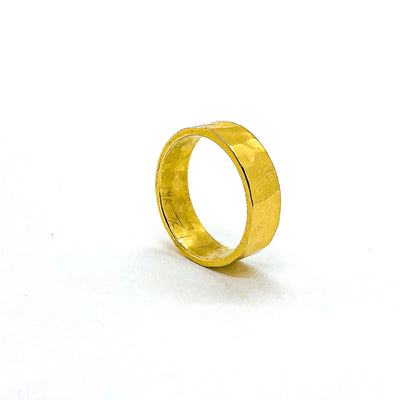 side angle view of 8mm 14k Gold Hammered Band in size 8 by Judie Raiford
