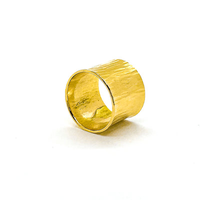 side angle view of 14k Gold Wide Hammered Band by Judie Raiford