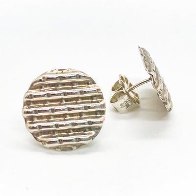 front and side view of sterling silver Corrugated Series Disc Earrings by Judie Raiford