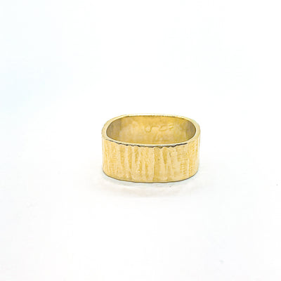 front view of 14k Gold Cross Pein Hammered Band by Judie Raiford