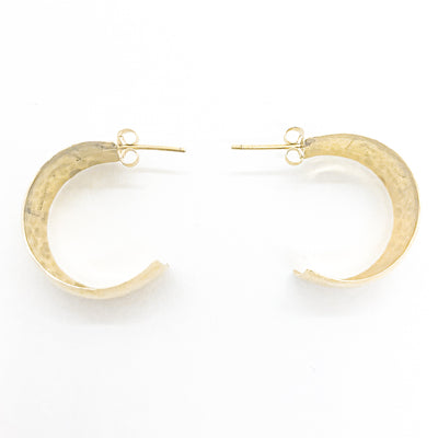 flat lay view of 14k Gold Wedding Ring Hoop Earrings by Judie Raiford