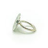 left side view of size 6.75 Sterling Round Cup Ring with Peridot by Judie Raiford