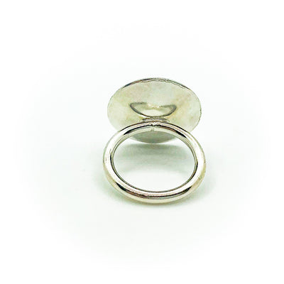 back side view of size 6.75 Sterling Round Cup Ring with Peridot by Judie Raiford