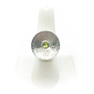 size 6.75 Sterling Round Cup Ring with Peridot by Judie Raiford on white ring display stand