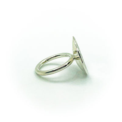right side view of size 6.75 Sterling Round Cup Ring with Peridot by Judie Raiford