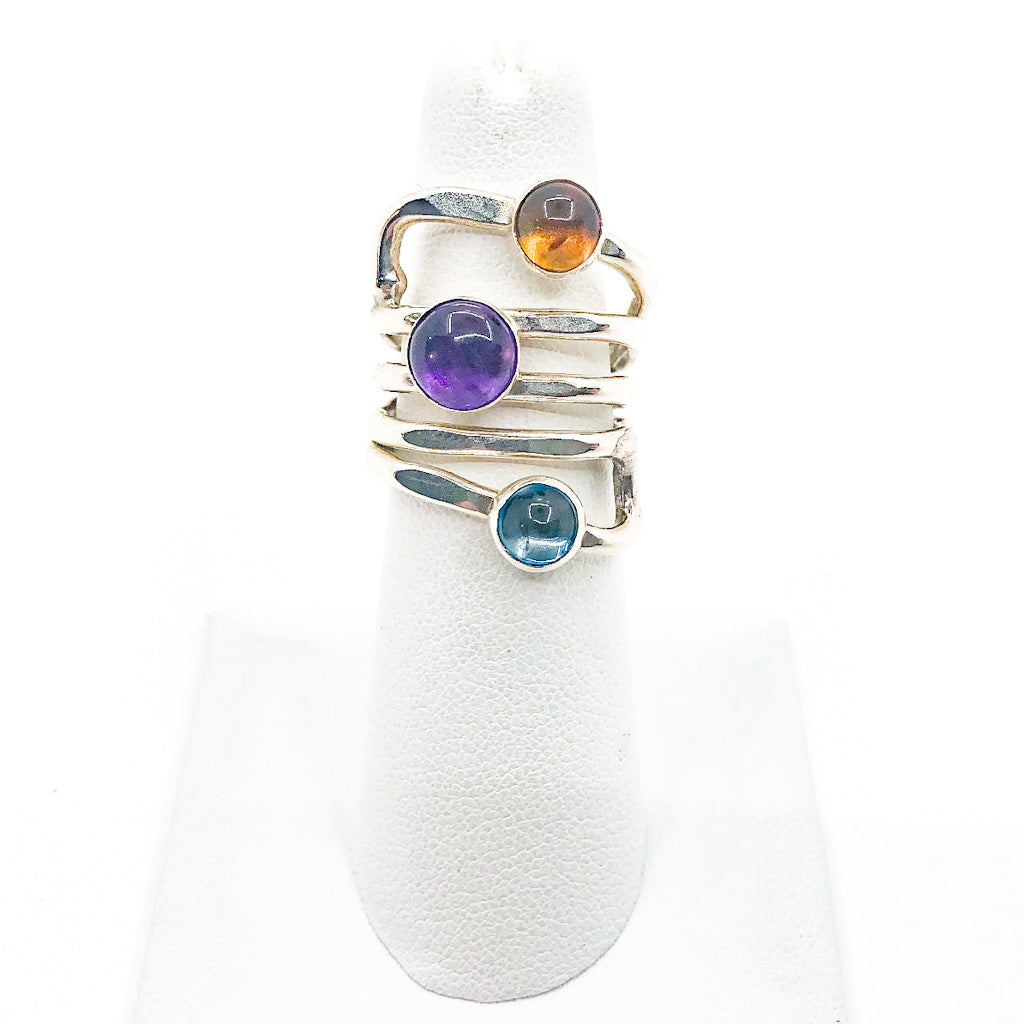 size 6.75 Sterling  Square Wrap Ring with Lemon Citrine, Blue Topaz, and Amethyst by Judie Raiford on white ring display stand