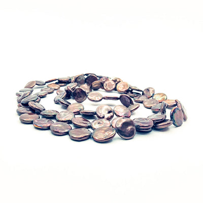 side angle view of Chocolate Coin Pearl Necklace by Judie Raiford