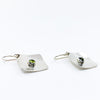 side angle view of Sterling Non Stick Earrings with Peridot by Judie Raiford