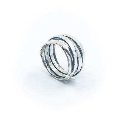 side angle view of size 10.75 Men's Sterling Flattened Random Theory Ring by Judie Raiford