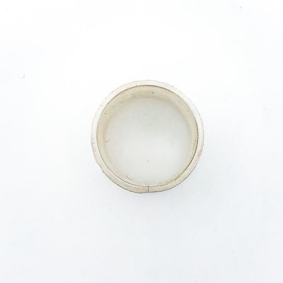 over top view of Sterling Anticlastic X Hammered Ring with 14k Ball by Judie Raiford