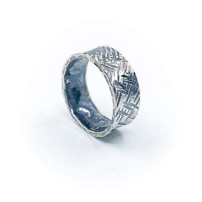 side angle view of size 11 Men's Oxidized Sterling Cross Hatch Band Ring by Judie Raiford