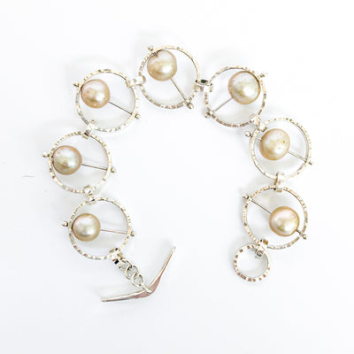 Flat Lay view of Not Naught Round Sterling Bracelet with Champagne Pearls by Judie Raiford