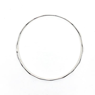 over top view of Sterling Orbit Bangle by Judie Raiford