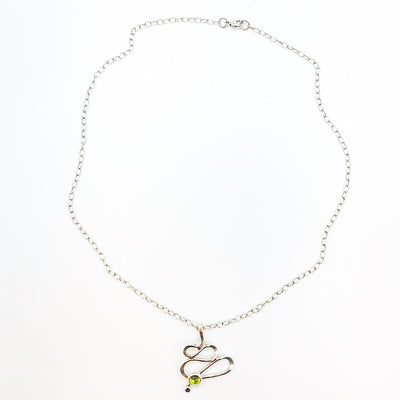flat lay view of sterling silver Touch of Romance Necklace with Peridot by Judie Raiford