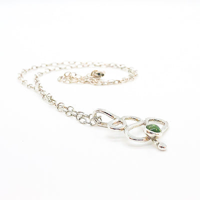 side angle view of sterling silver Touch of Romance Necklace with Peridot by Judie Raiford