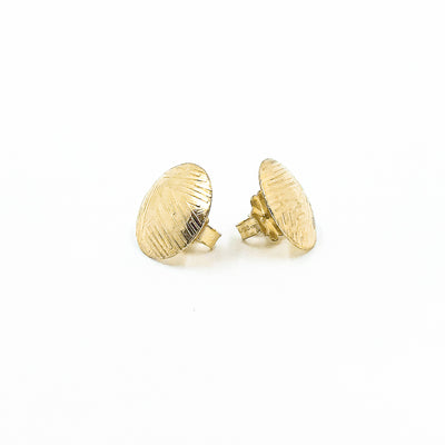 side angle view of 14k Gold Filled Textured Mini Disc Stud Earrings by Judie Raiford