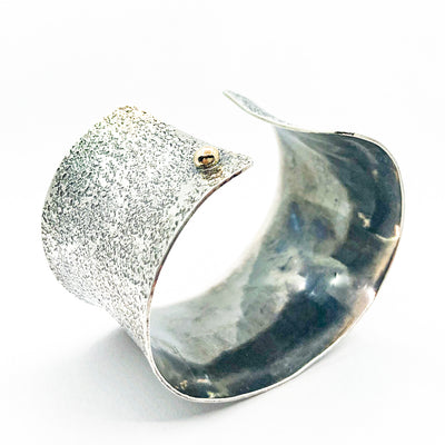 "side angle view of 1.5"" Oxidized Sterling Wide Anticlastic Cuff by Judie Raiford"
