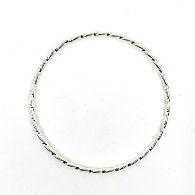 over top view of Sterling Double Twist Bangle by Judie Raiford
