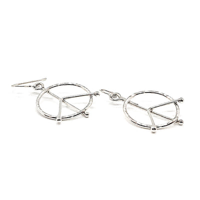 side angle view of sterling silver Small Hammered Peace Sign Earrings by Judie Raiford